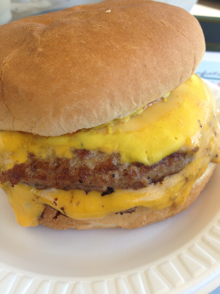 a mouth-watering double cheeseburger at Old Man River