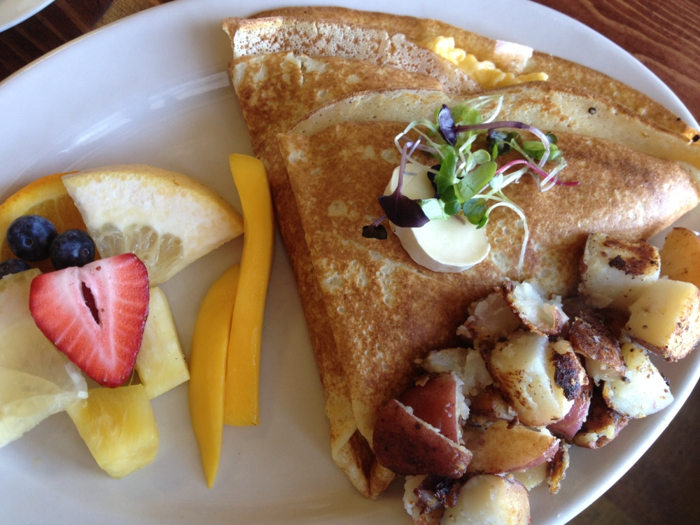 Sauteed apples, brie, & candied walnuts crepe (a lovebird favorite!) With breakfast potatoes & fruit