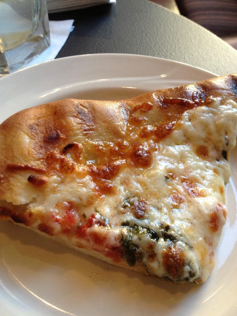 Classic Flat Iron Pizza sampler- mozzarella, basil, tomatoes. Osteria uses a flat iron of 500 degrees to make their pizzas!