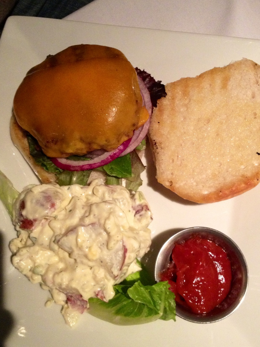 Axis venison burger with potato salad