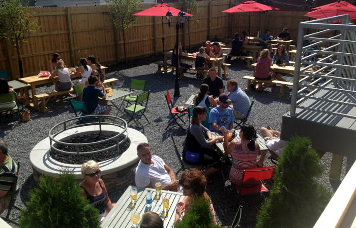 Step Out Buffalo's shot of Resurgence Brewery fire pit & patio